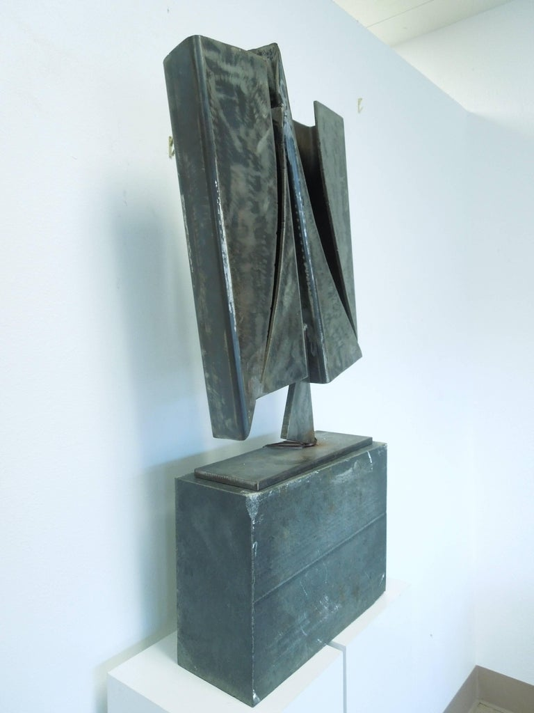 A two-piece heavy all steel modern art sculpture. From an upscale Art Collector's Palm Spring Estate. Signed LF.