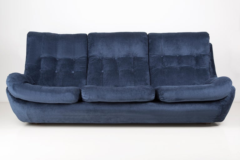 Atlantis sofa from the 1960s, produced in Czech Republic - at the moment they are unique. Due to their dimensions, they perfectly blend in even in small apartments providing comfort and beautiful decoration. Covered with high-quality velvet fabric,