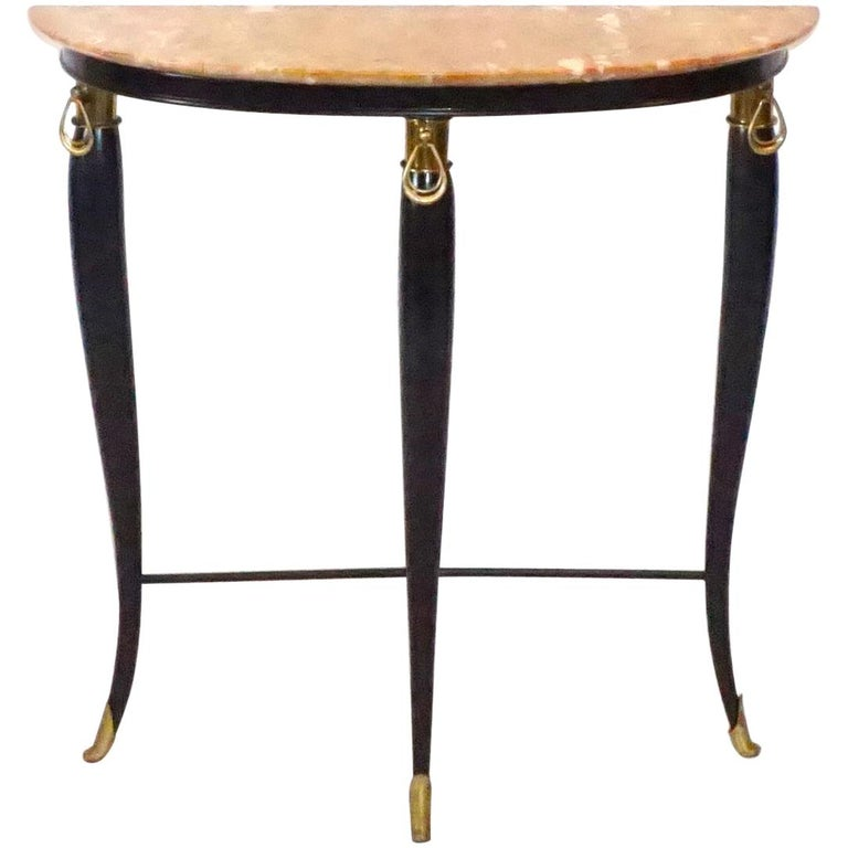 A vintage Art Deco Italian neoclassical style demilune console table, designed by Paolo Buffa, in a stunning curved shape, carved rosewood and an original Brescia Primavera marble top with gilded sabots in good condition. Wear consistent with age