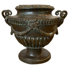 20th Century Neoclassical Oval Bronze Urn with Rams Heads