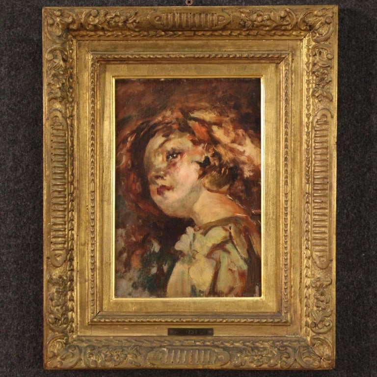 Italian painting from the first half of the 20th century. Framework oil on panel depicting a portrait of a girl of good pictorial quality. Painting showing on the back of the panel and on the plate applied on the front a reference to Vincenzo Irolli