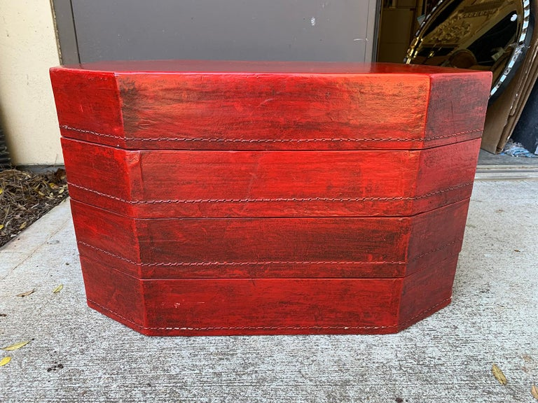 20th century oriental lacquered red drinks table. Four stacked boxes.
