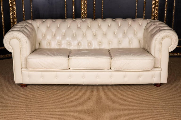 The Chesterfield sofa is covered with real, finest leather. The leather is of best quality, very easy to maintain and durable in use. At the same time, it is very gentle and smooth.  A rarity in this absolute top quality.  The color is simply