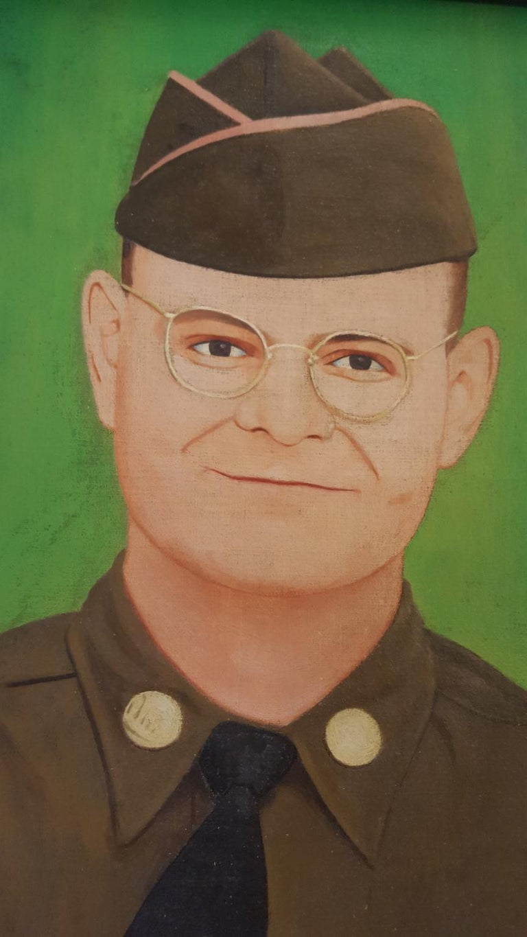 A small oil painting on canvas. It is a naive portrait of an American soldier in uniform. It appears to be framed in a handmade oak frame along with handcrafted pine stretcher bars, and pine turn pieces as levers to hold the painting in the frame.
