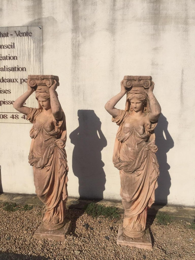 Beautiful 20th century, pair of antique Greek cariatide stone statues from the 1950s. Ideal for garden. Terracotta color. A cariatid of ancient Greek literally means