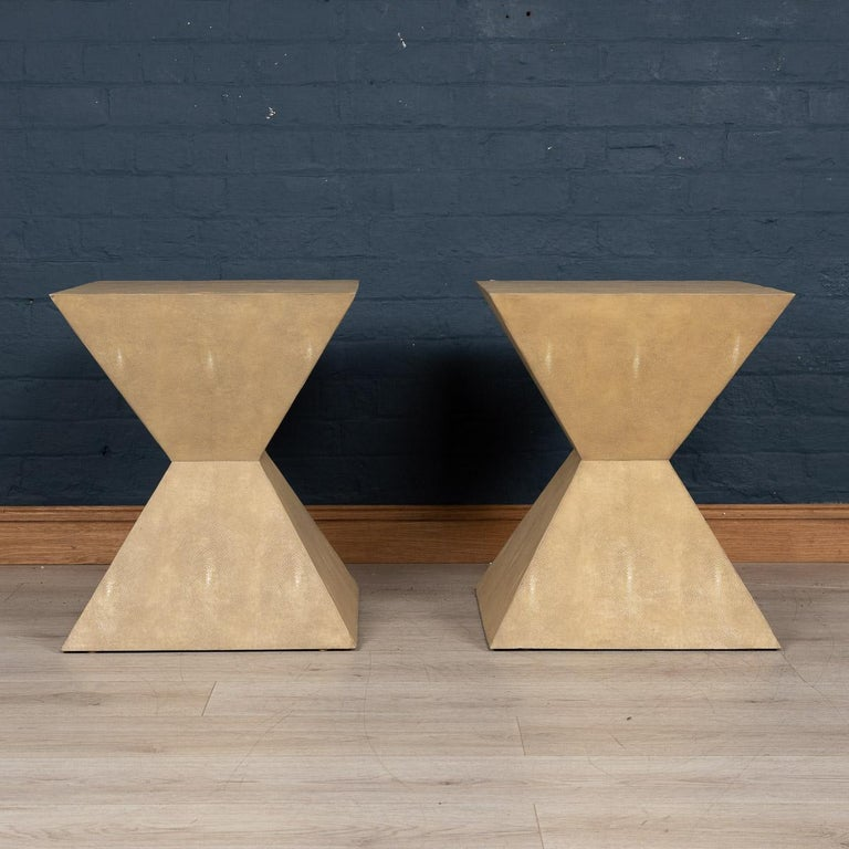A lovely pair of Art Deco inspired side tables, by Julian Chichester, London. Made in the latter part of the last century, veneered in faux shagreen. Shagreen is an exotic shark skin often used on Art Deco furniture of the 1930s, highly prized