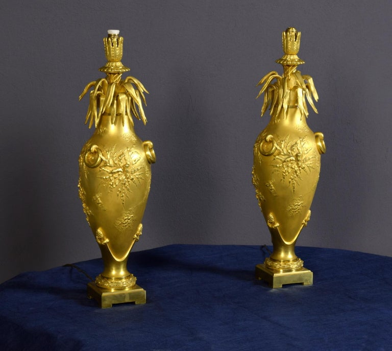 Art Nouveau 20th Century Pair of French Chiselled and Gilt Bronze Lamps For Sale