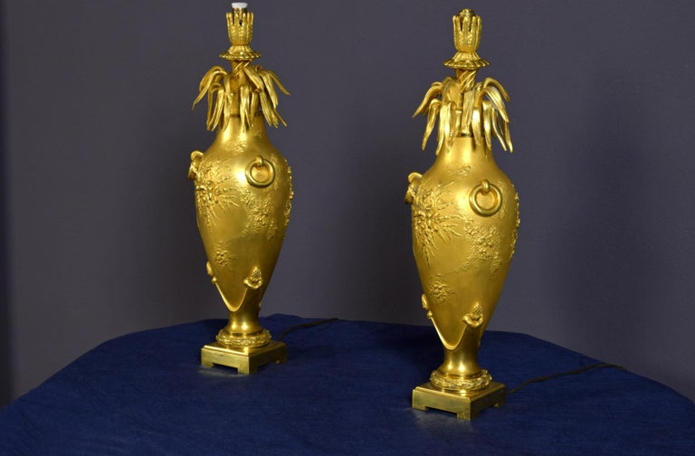 20th Century Pair of French Chiselled and Gilt Bronze Lamps For Sale 1