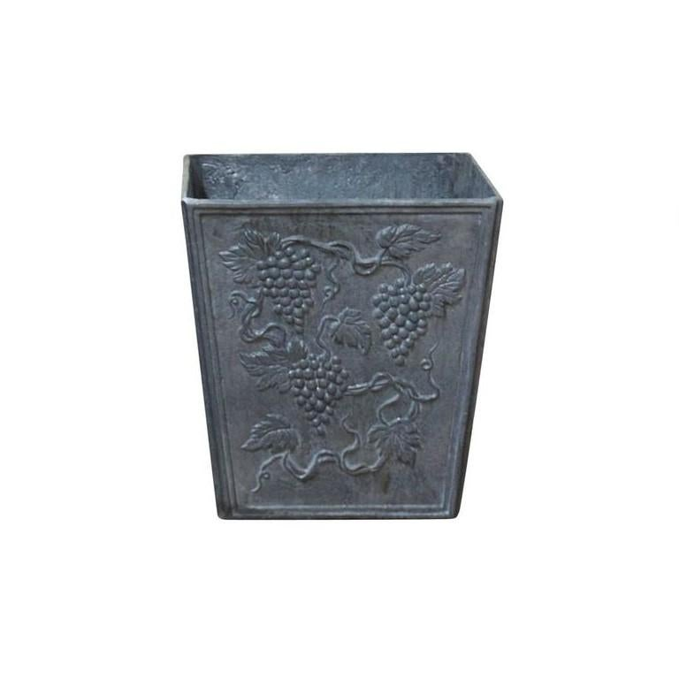 A vintage finely worked pair of square, simple in shape tapered lead planters with 19th century Victorian style grape vine decor on all four sides and framed with a simple bevel, in good condition. Wear consistent with age and use, circa 1960,