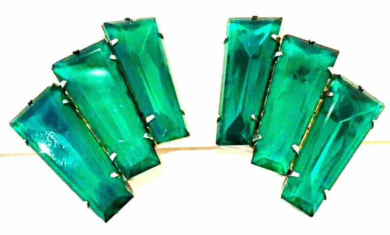 20th Century Pair Of Monumental Art Deco Style Silver & Austrian Crystal Emerald Earrings. These classic, timeless and coveted Art Deco style earrings feature silver plate fancy prong set hug brilliant cut and faceted emerald green Austrian crystal