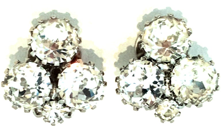 20th Century Pair Of Silver & Austrian Crystal Abstract Earrings By, Weiss. These classic and timeless finely crafted clip style earrings feature silver rhodium plate prong set brilliant cut and faceted colorless Austrian Crystal stones.