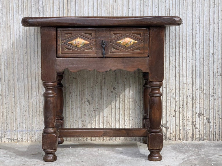 Carved 20th Century Pair of Spanish Nightstands with Drawer and Iron Hardware For Sale