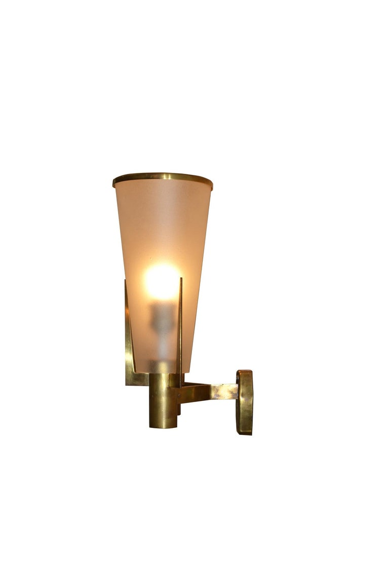Pair of Stilnovo sconces designed in 1950s with structure in golden brass and diffusers in etched glass. Presence of Stilnovo brand on the middle of each sconce. Very good condition.