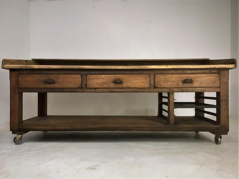 A very rare baker's table sourced from a long standing bakery in Liverpool, England; which was sadly closing it's doors for the final time. These bakers' tables feature solid pine bases and beautiful pale sycamore tops; unusually, this one has a