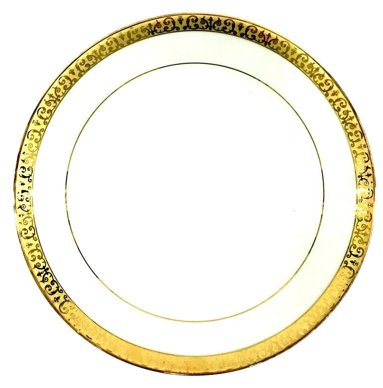 20th century porcelain and 22-karat gold dinnerware