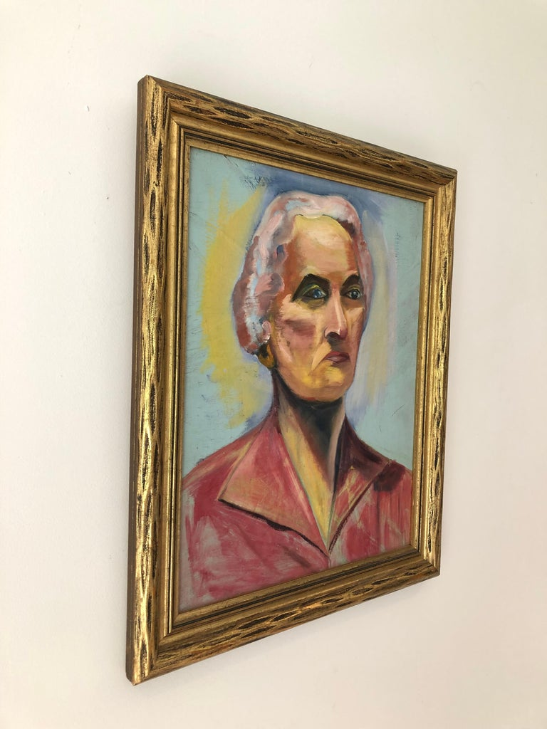 A mid-20th century oil on board painting of a woman. In a similar period giltwood frame. Unsigned. Measures: Sight 13.5