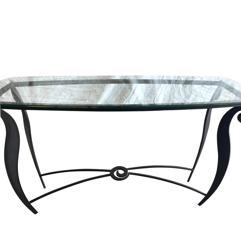 A vintage Mid-Century Modern Italian Pucci De Rossi console table with metal base and glass top, in good condition. Wear consistent with age and use. Circa 1970 - 1980, Italy.  Pucci De Rossi was an Italian designer, artist and sculptor born in 1947