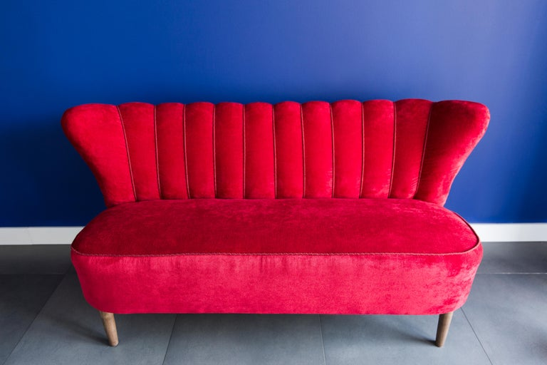 Beautiful club sofa from the 1960s, produced in Germany - at the moment they are unique. Due to their dimensions, they perfectly blend in even in small apartments providing comfort and beautiful decoration. Covered with high-quality velvet fabric, a