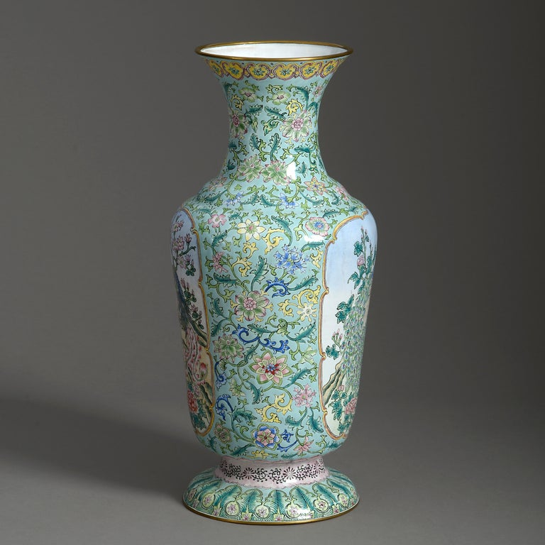 A mid-20th century republic period canton enamel vase of good scale, decorated in polychrome glazes with scrolling foliage upon a turquoise ground, the cartouches with stylised peacocks.