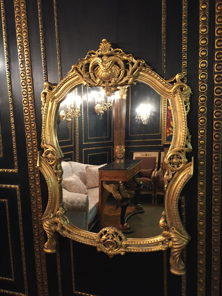 Splendid Rococo wall-mirror with Gold leaf. Solid beechwood, finely carved, hand painted and gilded.