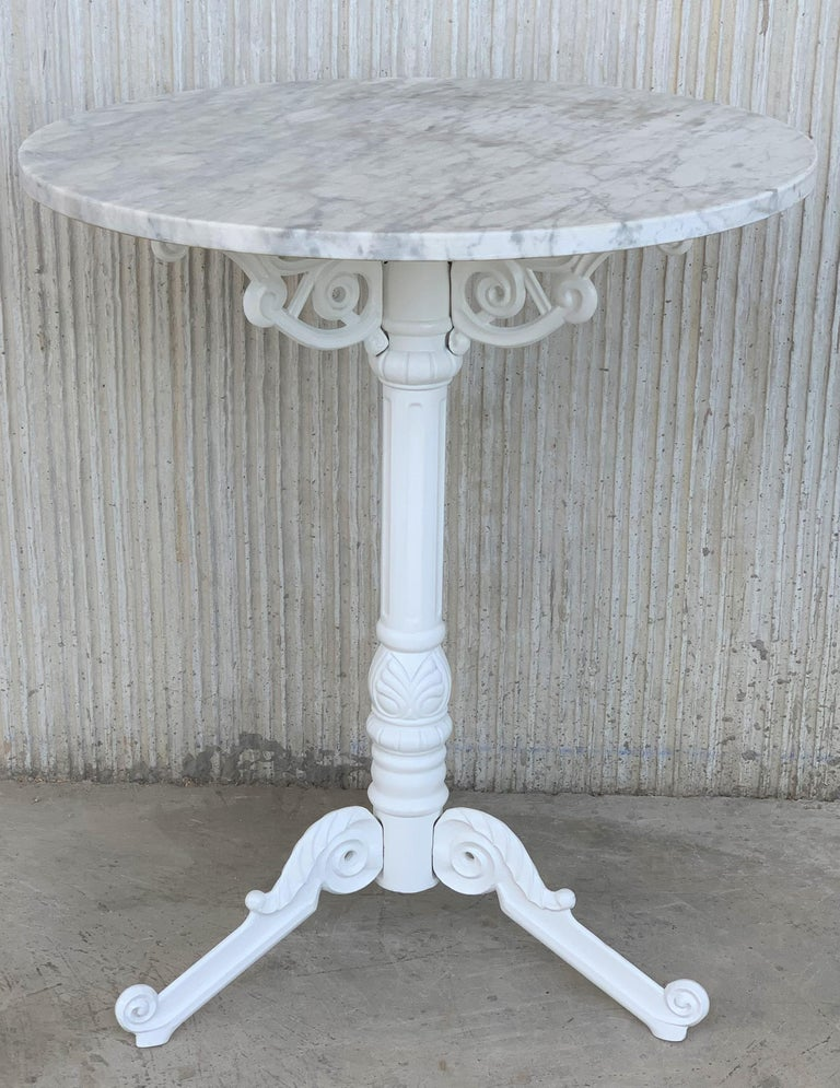 French style cast iron base with marble top garden table or bistro table.  Finely detailed cast iron base with white marble top.  Indoor and outdoor.