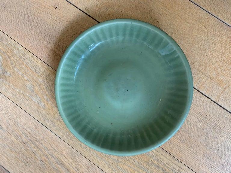 20th century round celadon glazed pottery plate.