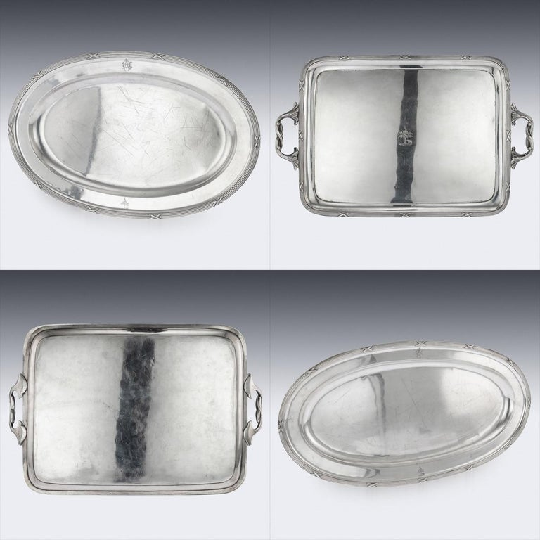 Antique early 20th century Russian Empire extensive solid silver dinner service, large and of heavy gauge. Consisting; serving tray, two tureens, two sauce boats, two oval dishes, two round dishes. Of traditional design and decorated with