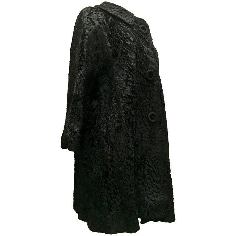 1960'S Black Persian Lamb Fur Swing Coat. Gorgeous jet black sculpted Persian lamb swing style car coat features, adorable oversized made of lamb buttons, Peter Pan Collar, three quarter inch bell sleeves,  two exterior side pockets. Fully lined