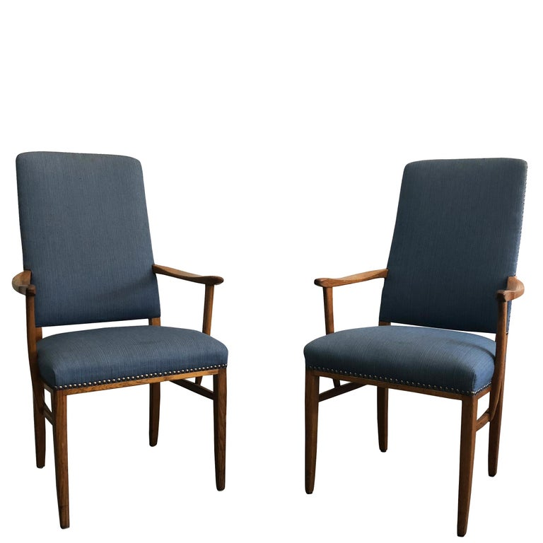 """A rare set of very comfortable 21 dining Gustavian arm chairs from Carl Malmsten very elegant and striking design. Upholstered in blue fabric. Wear consistent with age and use. Circa 1940 – 1950, Sweden.  Seat: 19"""" H x 18"""" D.  Carl Malmsten was a"""