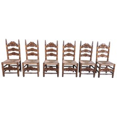 20th Century Set of Six Catalan Chairs in Carved Walnut and Caned Seats