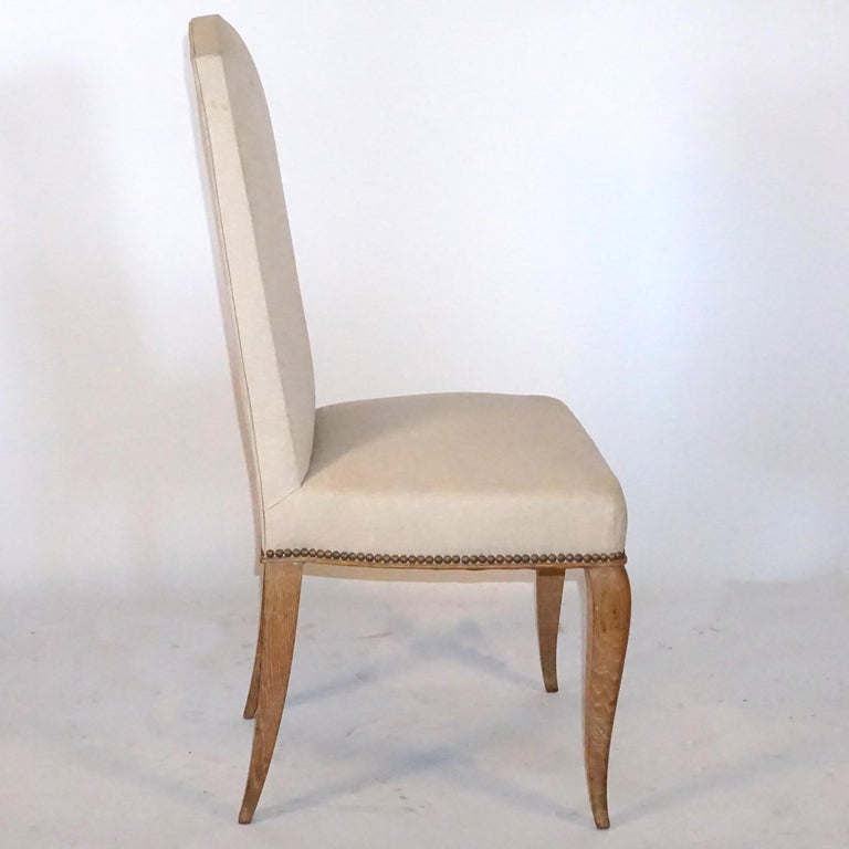 A set of six French reused oak dining chairs, with high backrest recovered in velvet fabric.