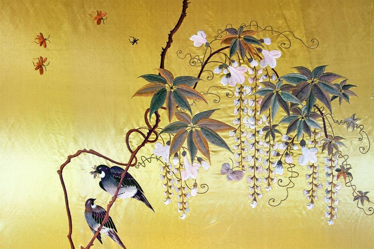 Showa period. Elegant large silk panel embroidered yellow gold with herons, wisteria and butterflies.