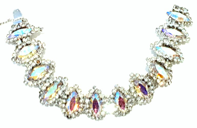 20th Century Silver & Austrian Crystal Link Bracelet By, Weiss. This finely crafted silver rhodium plate link bracelet features twelve dimensional links with fancy prong set  navette Aurora Borealis stones with applied silver and colorless stones