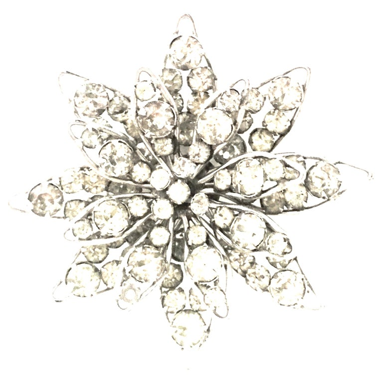 20th Century Silver & Crystal Dimensional Necklace Pendant & Brooch By,  Nat Halpern. This silver plate necklace pendant and brooch is three dimensional and has an abstract floral or starburst motif. The Austrian brilliant cut and faceted colorless