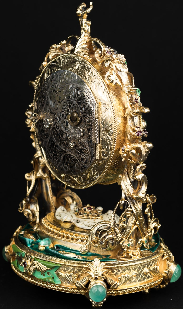 Austrian silver-gilt clock with green enamel, 20th century. The back is engraved with scrolls.