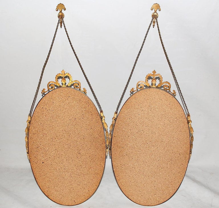 Art Deco 20th Century Small Swedish Pair of Oval Brass Wall Mirrors For Sale