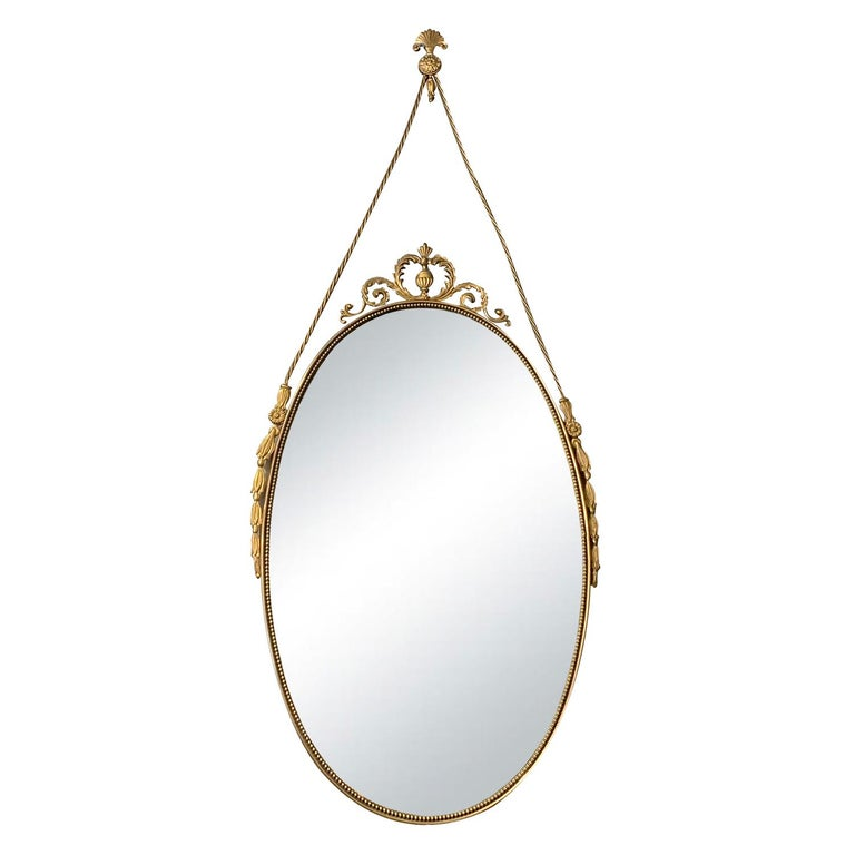 Hand-Crafted 20th Century Small Swedish Pair of Oval Brass Wall Mirrors For Sale