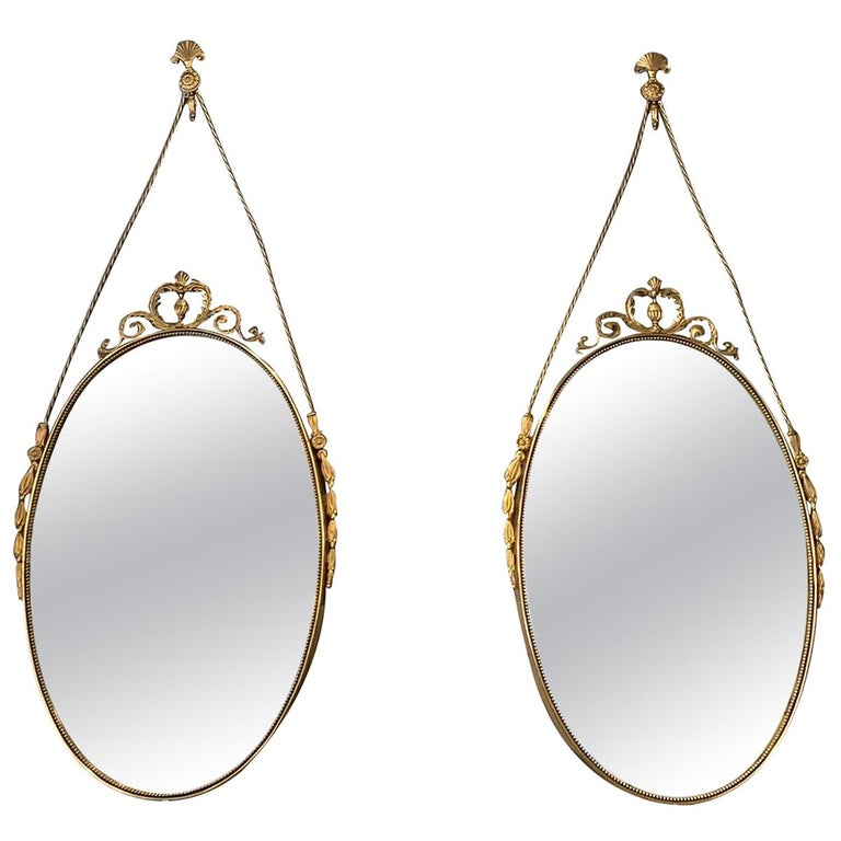 20th Century Small Swedish Pair of Oval Brass Wall Mirrors For Sale