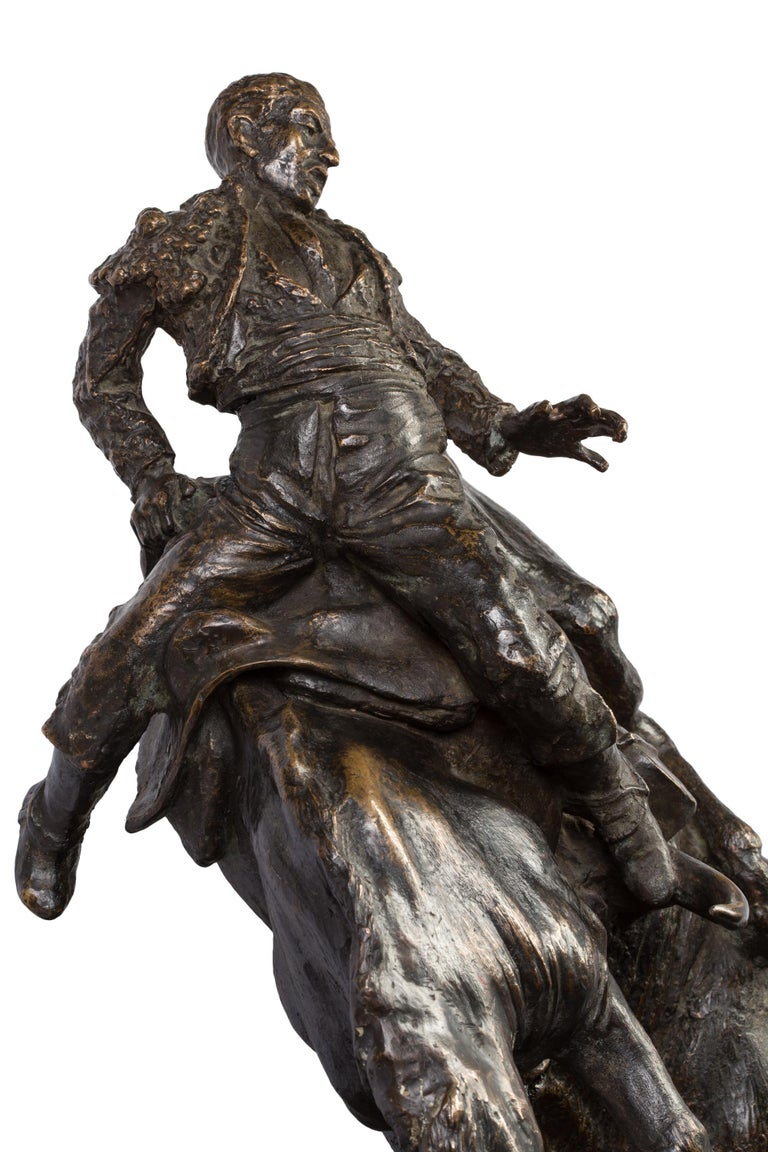 This highly dynamic bronze of a bull attacking a picador on horseback was created by Spanish sculptor Juan Polo Velasco in 1948. Born in the Andalucian city of Fernán Núñez in 1923, Juan Polo began sculpting at a young age, attended art schools in