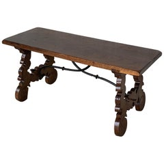 20th Century Spanish Carved Table with Iron Stretchers