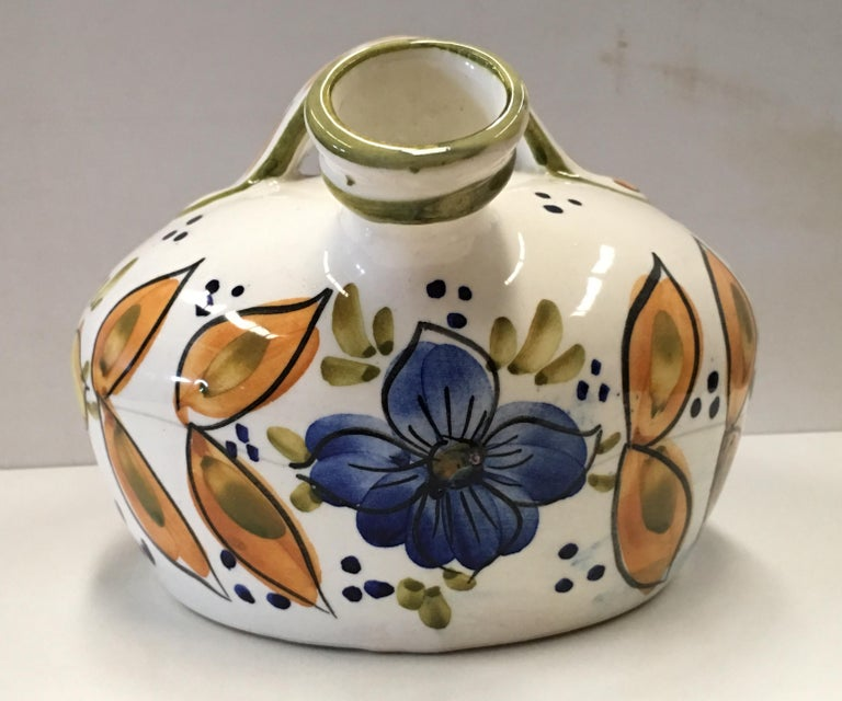 20th century Spanish glazed cruche or pitcher The purpose of storing water in an earthenware pitcher is to keep the water cool.