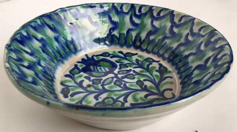 20th Spanish hand thrown ribbed blue-green glaze studio pottery bowl with Fleurs depicting.