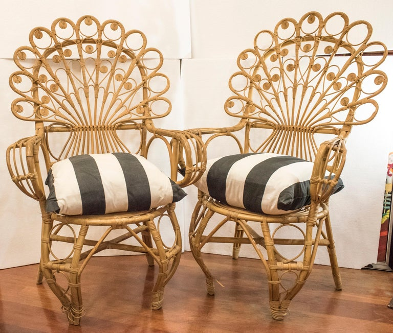 Amazing and rare couple of Spanish wicker armchairs .They are in very good condition with age and use, only a few little ornamental losses but the structure and the seat in perfect condition. They are really a delightful works of crafts, and sadly