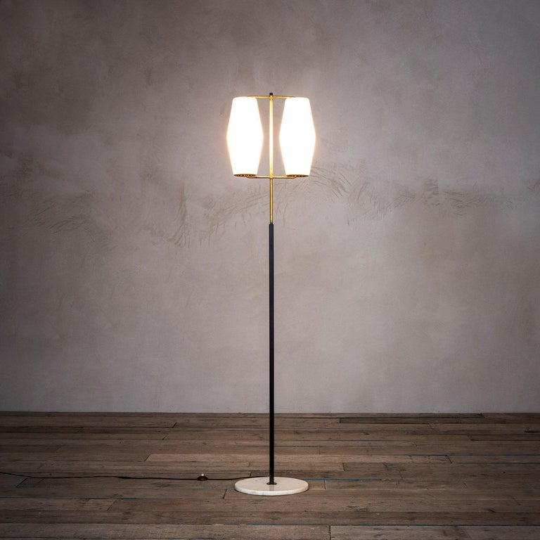 Floor lamp by Stilnovo of '50s with base in white marble, structure in brass and lacquered metal, couple of diffusers in opal glass.  Very good condition, original in all its parts, fully working.