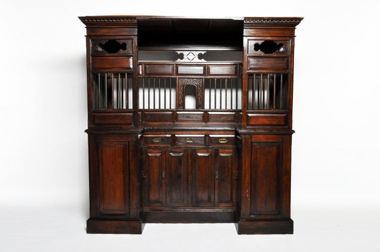 This impressive ticket booth is from Rangoon, Burma and was made from teak wood and metal, circa 20th century. Wear consistent with age and use. The piece is resistant to humidity and insects.
