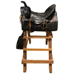 20th Century Tooled Leather Saddle and Rustic Wood Stand