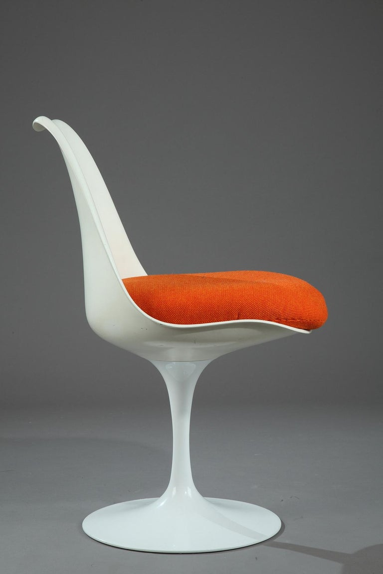 Tulip Chair in bright white metal, with new upholstery in orange fabric. The Tulip Chair is a mythical chair of the 1950s. It was created in 1956 by the designer Eero Saarinen (1910-1961) for Knoll,  circa 1950 Dimensions: W 19.3 in, D 19.7in, H