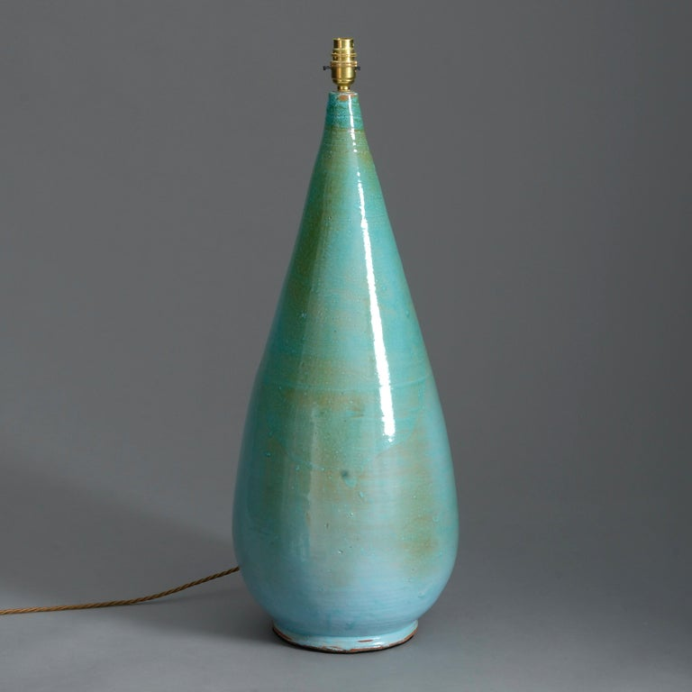 A tall mid-20th century Studio Pottery vase, the body with a striking variegated turquoise glaze.