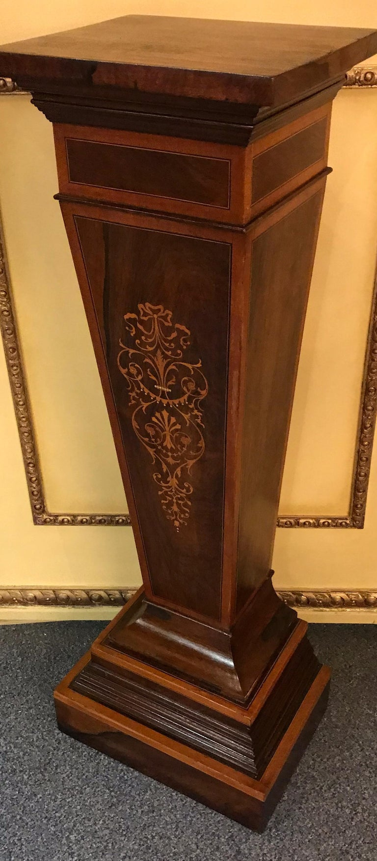 Unique English column pedestal, Victorian. Solid wood with rosewood veneer and rich inlaid work.  Profiled and stepped base leg also made of rosewood veneer.  (K-).