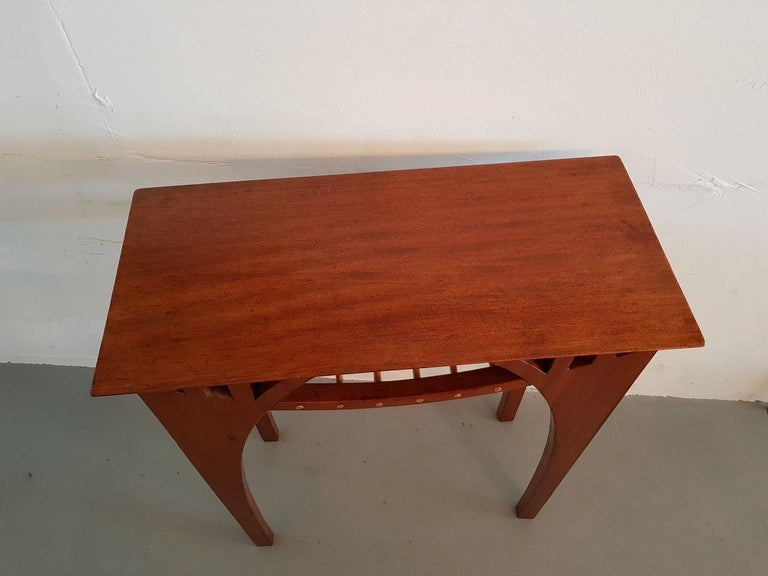 Vintage design teak side table with additional platform under the top for magazines (slight wear on the blade by use and age), second half of the 20th century.  The measurements are: Depth 30 cm/ 11.8 inch. Width 60 cm/ 23.6 inch. Height 78 cm/